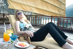 Relax on sun deck Valentine Cruises Halong Bay